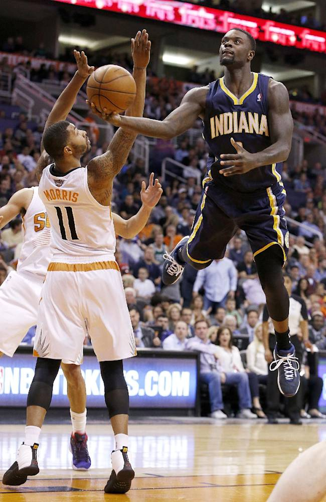 Indiana Pacers' Lance Stephenson, right, tries to get off a shot against Phoenix Suns' Markieff Morris (11) during the first half of an NBA basketball game Wednesday, Jan. 22, 2014, in Phoenix