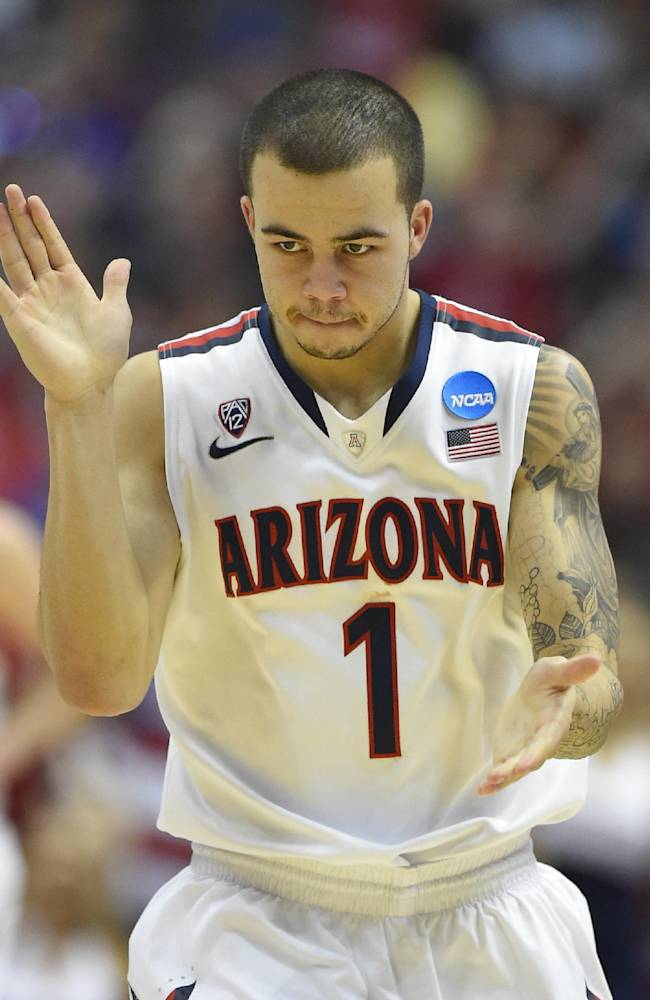 Arizona guard Gabe York (1) cheers during the second half in a regional semifinal NCAA college basketball tournament game against San Diego State, Thursday, March 27, 2014, in Anaheim, Calif