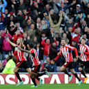Sunderland's Seb Larsson, left, celebrates his goal with his teammates during their English Premier League soccer match against Everton at the Stadium of Light, Sunderland, England, Sunday, Nov. 9, 2014