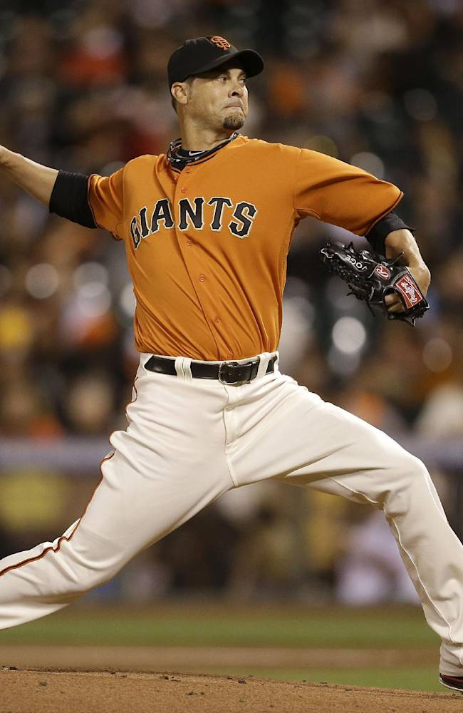 San Francisco Giants pitcher Ryan Vogelsong throws against the San Diego Padres during the first inning of a baseball game in San Francisco, Friday, Sept. 27, 2013
