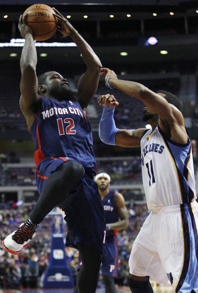 Detroit Pistons guard Will Bynum (12) tries to shoot against Memphis Grizzlies guard Mike Conley (11) during the second half of an NBA basketball game on Sunday, Jan. 5, 2014, in Auburn Hills, Mich. The Grizzlies defeated the Pistons 112-84