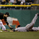 Milwaukee Brewers' Scooter Gennett, right, is caught stealing as Pittsburgh Pirates second baseman Neil Walker (18) applies the tag after taking a throw from catcher Russell Martin during the seventh inning of a baseball game in Pittsburgh, Thursday, Apri
