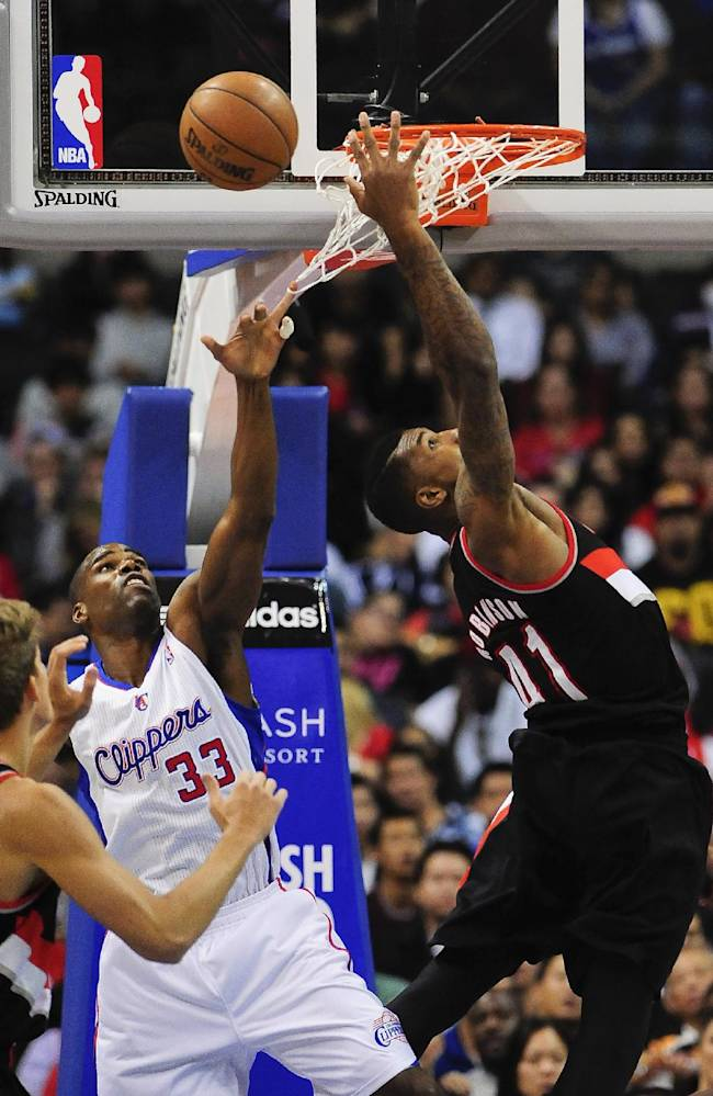 Los Angeles Clippers forward Antawn Jamison (33) and Portland Trail Blazers forward Thomas Robinson (41) fight for the rebound in the second half of a pre-season NBA basketball game, Friday, Oct. 18, 2013, in Los Angeles. The Trail Blazers won 94-84