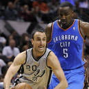 San Antonio Spurs shooting guard Manu Ginobili, left, of Argentina, drives around Oklahoma City Thunder center Kendrick Perkins during the first half of an NBA basketball game, Saturday, Dec. 21, 2013, in San Antonio. (AP Photo/Darren Abate)