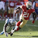 San Francisco 49ers running back Frank Gore (21) runs past Carolina Panthers outside linebacker Thomas Davis (58) during the second half of an NFL football game in San Francisco, Sunday, Nov. 10, 2013 The Associated Press