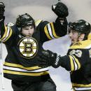 In this May 1, 2014, file photo, Boston Bruins defenseman Johnny Boychuk, left, raises his arms as he celebrates his tying goal, which forced the game into overtime, against the Montreal Canadiens during the third period of Game 1 in the second round of t