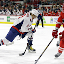 Washington Capitals' Alex Ovechkin (8), of Russia, skates against Carolina Hurricanes' Eric Staal (12) during the first period of an NHL hockey game in Raleigh, N.C., Thursday, Dec. 4, 2014 The Associated Press