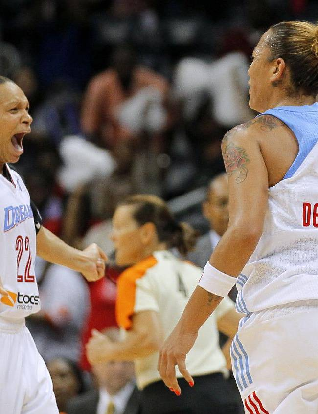 Atlanta Dream center Erika de Souza (14) and guard Armintie Herrington (22) celebrate a basket late in the fourth quarter in Game 3 of aWNBA basketball Eastern Conference semifinal series against the Washington Mystics, Monday, Sept. 23, 2013, in Atlanta. The Dream won 80-72