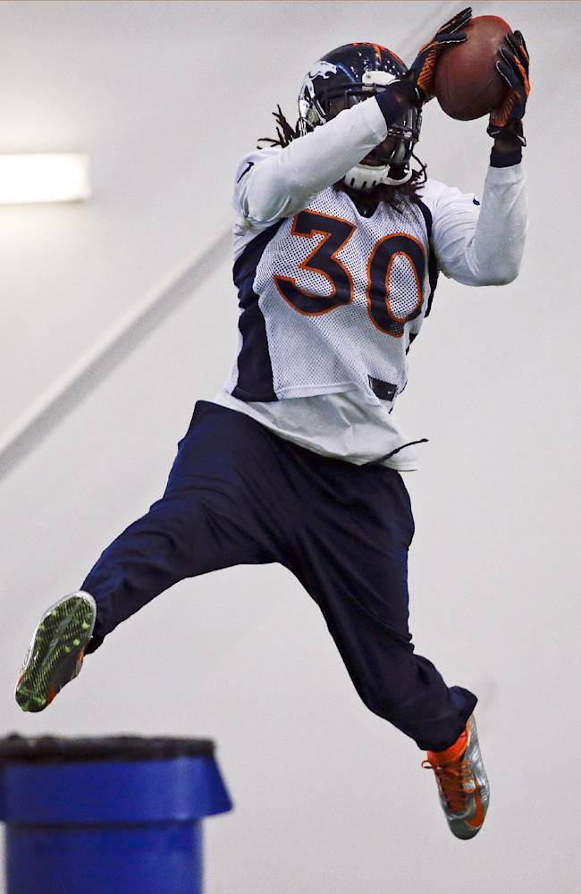 Denver Broncos safety David Bruton catches a pass during practice Thursday, Jan. 30, 2014, in Florham Park, N.J. The Broncos are scheduled to play the Seattle Seahawks in the NFL Super Bowl XLVIII football game Sunday, Feb. 2, in East Rutherford, N.J. (AP Photo)