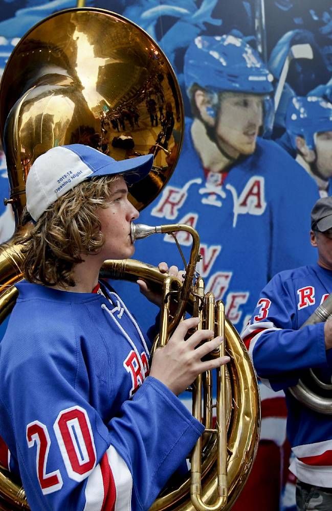 Max Schrader, left, and his father Paul Schrader play a tubas outside Madison Square Garden before Game 3 of the NHL hockey Stanley Cup Final between the Los Angeles Kings and New York Rangers, Monday, June 9, 2014, in New York