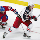 Columbus Blue Jackets' Ryan Johansen, right, celebrates after scoring against the Montreal Canadiens as Canadiens' Jarred Tinordi, left, and Mike Weaver defend during the third period of an NHL hockey game in Montreal, Thursday, March 20, 2014 The Associa