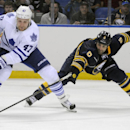 Toronto Maple Leafs' Leo Komarov (47) gets by the reach of Buffalo Sabres' Mike Weber (6) during the second period of an NHL hockey preseason game, Friday, Sept. 26, 2014, in Buffalo, N.Y. Toronto won 6-4. The Associated Press