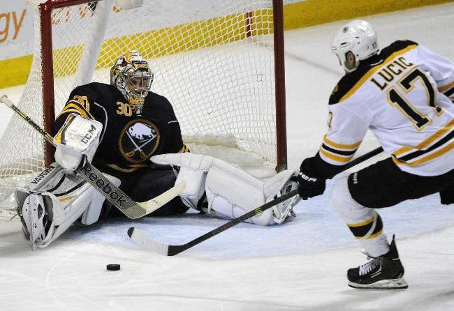 Buffalo Sabres goaltender Ryan Miller (30) makes the save as Boston Bruins left winger Milan Lucic (17) moves toward the loose puck during the third period of an NHL hockey game in Buffalo, N.Y., Thursday, Dec. 19, 2013. Buffalo won 4-2