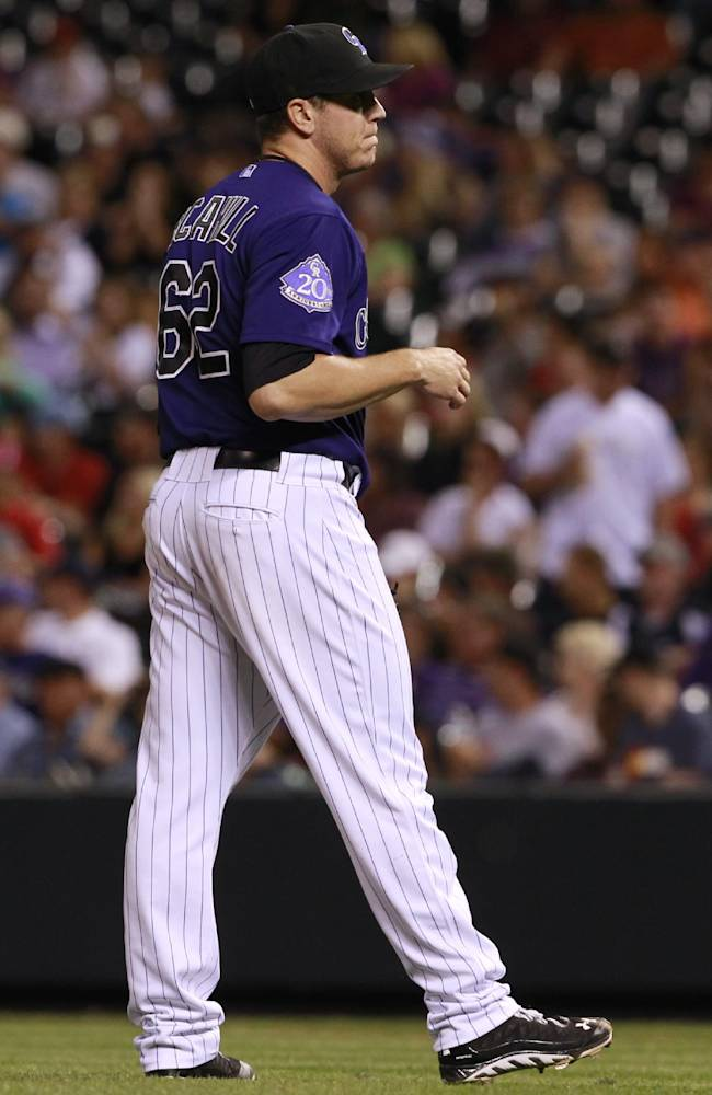 Colorado Rockies relief pitcher Rob Scahill reacts after giving up a two-run home run to St. Louis Cardinals' Matt Holliday in the fifth inning of the Cardinals' 11-4 victory in a baseball game in Denver on Tuesday, Sept. 17, 2013