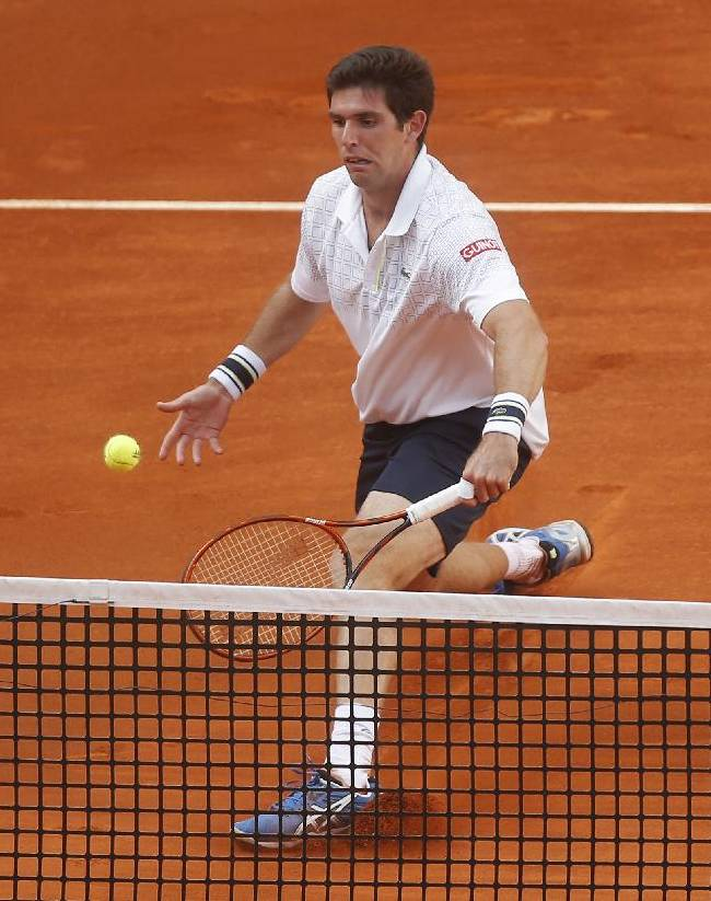 Federico Delbonis from Argentina returns the ball during a Madrid Open tennis tournament match against Feliciano Lopez from Spain in Madrid, Spain, Monday May 5, 2014