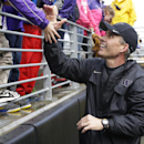 Washington coach Chris Petersen greets fans, Saturday, April 19, 2014, following Washington's spring NCAA college football preview in Seattle. The team held an open practice and limited scrimmage The Associated Press