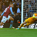 Manchester City's Joe Hart, right, saves from Aston Villa's Andreas Weimann during the English Premier League soccer match between Aston Villa and Manchester City at Villa Park, Birmingham, England, Saturday, Oct. 4, 2014