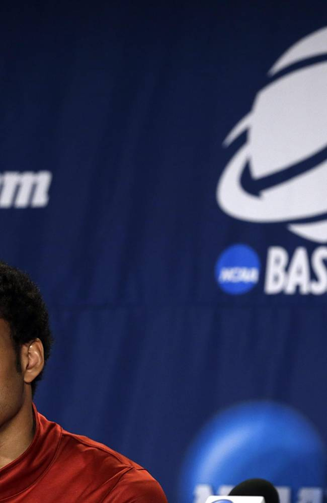 Stanford's Josh Huestis listens to a question during a news conference at the NCAA college basketball tournament Saturday, March 22, 2014, in St. Louis. Stanford plays Kansas in a third-round game on Sunday