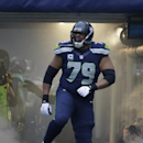 Seattle Seahawks' Red Bryant is introduced before an NFL football game against the St. Louis Rams, Sunday, Dec. 29, 2013, in Seattle The Associated Press