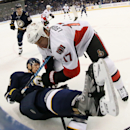 Ottawa Senators center David Legwand drops St. Louis Blues defenseman Carl Gunnarsson during the second period of an NHL hockey game, Tuesday, Nov. 25, 2014, at the Scottrade Center in St. Louis The Associated Press