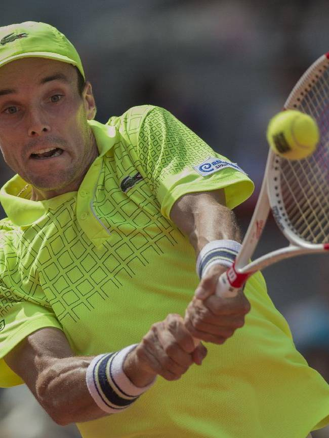 Roberto Bautista Agut returns the ball during a Madrid Open tennis tournament semifinal match against Rafael Nadal from Spain in Madrid, Spain, Saturday, May 10, 2014