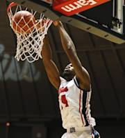 Mississippi forward Aaron Jones (34) dunks a basket against Auburn in the first half of an NCAA college basketball game in Oxford, Miss., Thursday, Jan. 9, 2014. (AP Photo/Rogelio V. Solis)