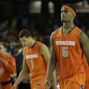 Syracuse basketball players walk off the court after the second half of the NCAA Final Four tournament college basketball semifinal game against Michigan, Saturday, April 6, 2013, in Atlanta. Michigan won 61-56. (AP Photo/David J. Phillip)