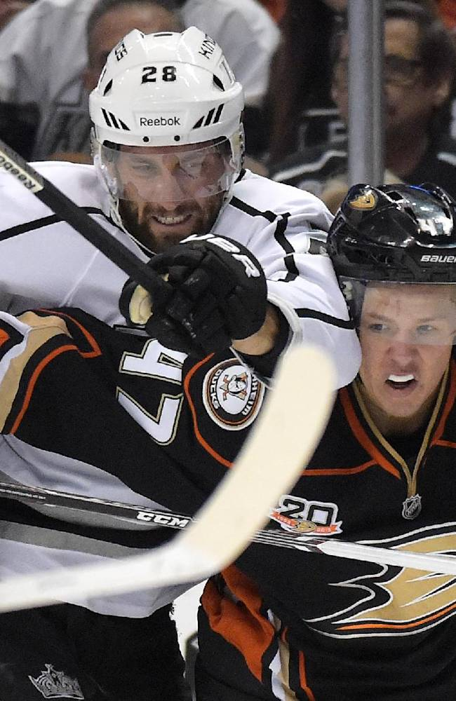 Los Angeles Kings center Jarret Stoll, left, and Anaheim Ducks defenseman Hampus Lindholm, of Sweden, battle for the puck during the first period in Game 2 of an NHL hockey second-round Stanley Cup playoff series, Monday, May 5, 2014, in Anaheim, Calif