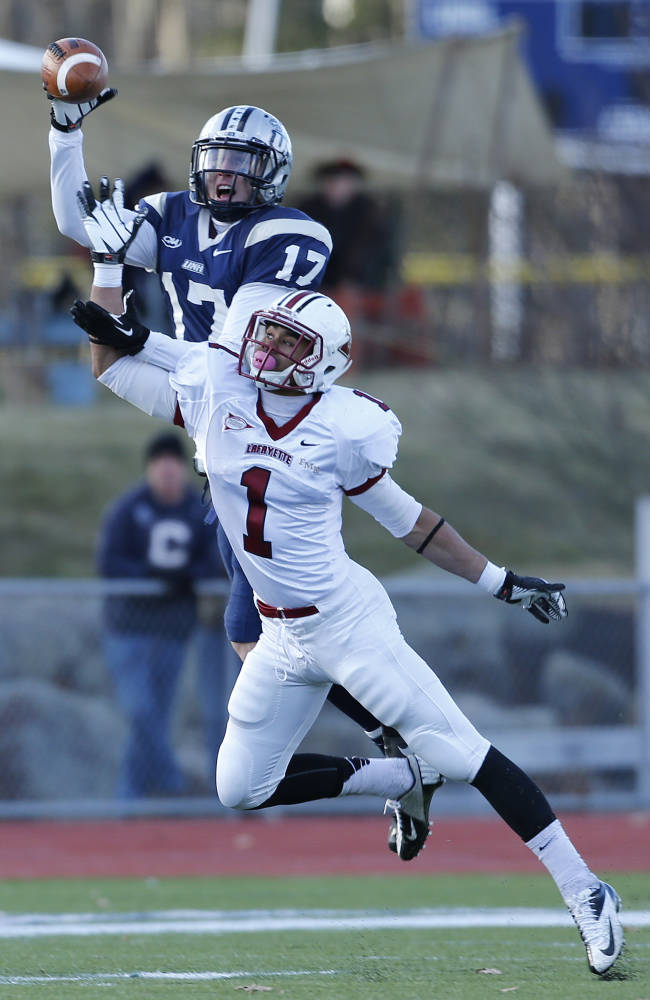 New Hampshire wide receiver Mike DeTroia (17) can't hold on to a pass while being defended by Lafayette defensive back Jared Roberts (1) in the second half of an NCAA college football playoff game, Saturday, Nov. 30, 2013 in Durham, N.H