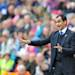Wigan Athletic manager Roberto Martinez shouts instructions to his team, during the English Premier League match against Wigan Athletic at the DW Stadium, Wigan, England, Sunday May 19, 2013. (AP Photo/PA, Martin Rickett)