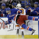 New York Rangers' John Moore (17) is checked by Philadelphia Flyers' Zac Rinaldo (36) during the first period in Game 1 of an NHL hockey first-round playoff series on Thursday, April 17, 2014, in New York The Associated Press
