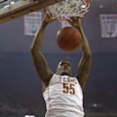 Texas center Cameron Ridley (55) dunks during the first half of an NCAA college basketball game against Long Beach State, Saturday, Dec. 20, 2014, in Austin, Texas. (AP Photo/Michael Thomas)