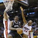 Brooklyn Nets guard Joe Johnson, center, goes up for a shot against Miami Heat forward Chris Andersen, left, and guard Ray Allen (34) during the second half of an NBA basketball game, Tuesday, April 8, 2014 in Miami. Johnson scored 19 points as the Nets d