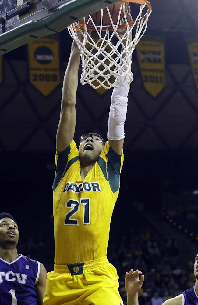 Baylor center Isaiah Austin (21) scores against TCU during the first half of an NCAA college basketball game Saturday, Jan. 11, 2014, in Waco, Texas