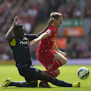 Liverpool's Joe Allen, right, fights for the ball against Southampton's Victor Wanyama during their English Premier League soccer match at Anfield Stadium, Liverpool, England, Sunday Aug. 17, 2014