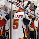 Calgary Flames center Mikael Backlund, left, celebrates with teammates after scoring against the Chicago Blackhawks in overtime of an NHL hockey game in Chicago, Wednesday, Oct. 15, 2014. The Flames won 2-1 The Associated Press
