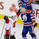 Calgary Flames' Mikael Backlund (11) celebrates the win in overtime as Edmonton Oilers Jordan Eberle (14) skates past during NHL hockey action in Edmonton, Alberta., on Saturday Dec. 7, 2013 The Associated Press
