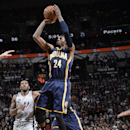 SAN ANTONIO, TX - December 7: Paul George #24 of the Indiana Pacers shoots the ball against the San Antonio Spurs during the game at the AT&T Center on December 7, 2013 in San Antonio, Texas