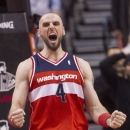Washington Wizards' Marcin Gortat celebrates scoring during the second overtime period against the Toronto Raptors in NBA basketball action in Toronto, Thursday, Feb. 27, 2014 The Associated Press