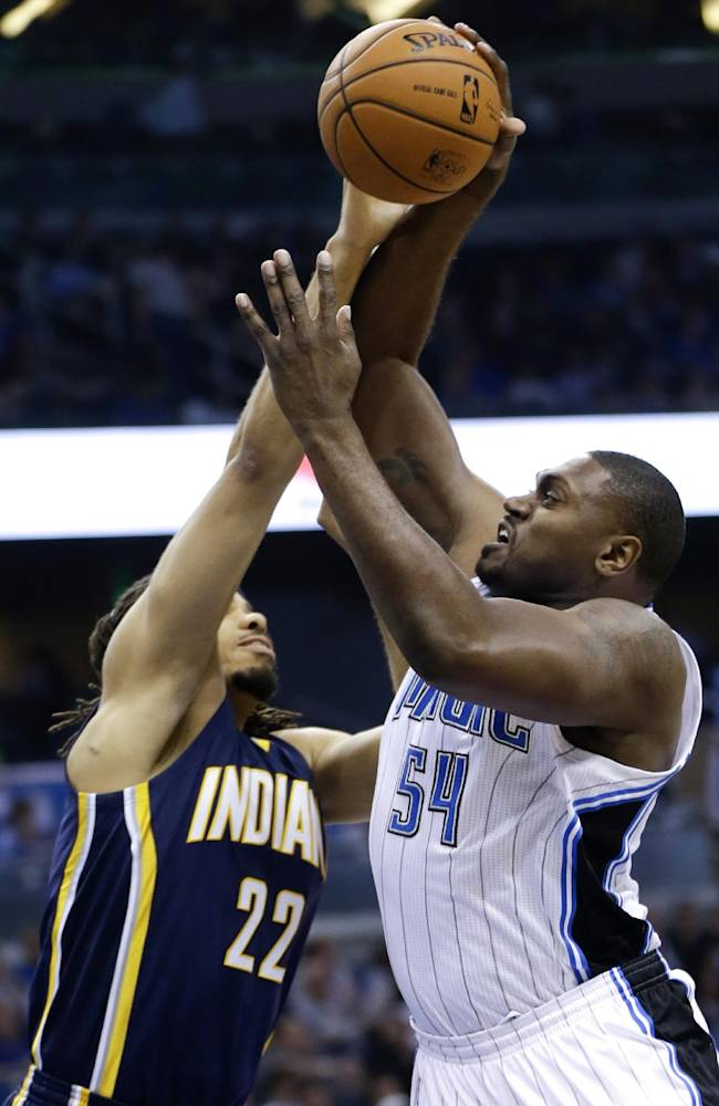 Orlando Magic's Jason Maxiell (54) attempts a shot over Indiana Pacers' Chris Copeland (22) during the first half of an NBA basketball game in Orlando, Fla., Wednesday, April 16, 2014