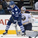 Toronto Maple Leafs' James van Riemsdyk tires to get a shot off against Buffalo Sabres goaltender Andrey Makarov during the first period of a preseason NHL game in Toronto on Sunday, Sept. 28, 2014. The Associated Press