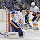 New York Islanders goalie Chad Johnson (30) makes a save as defenseman Johnny Boychuk (55) keeps Tampa Bay Lightning center Tyler Johnson from a rebound during the second period of an NHL hockey game, Saturday, Nov. 15, 2014, in Tampa, Fla The Associated