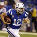 Indianapolis Colts quarterback Andrew Luck runs after being chased front he pocket by the New England Patriots during the first half of an NFL football game in Indianapolis, Sunday, Nov. 16, 2014 The Associated Press
