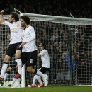 Manchester United's Daley Blind, left, celebrates with Marouane Fellaini after scoring during the English Premier League soccer match between West Ham United and Manchester United at the Boleyn Ground in London, Sunday, Feb. 8, 2015. (AP Photo/Alastair Gr