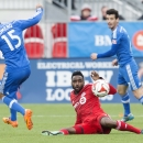 Toronto FC's Warren Creavalle, cener, clears the ball between Montreal Impact's Andres Romero, left, and Felipe Martins during the first half of an MLS soccer match, Saturday, Oct. 18, 2014, in Toronto The Associated Press