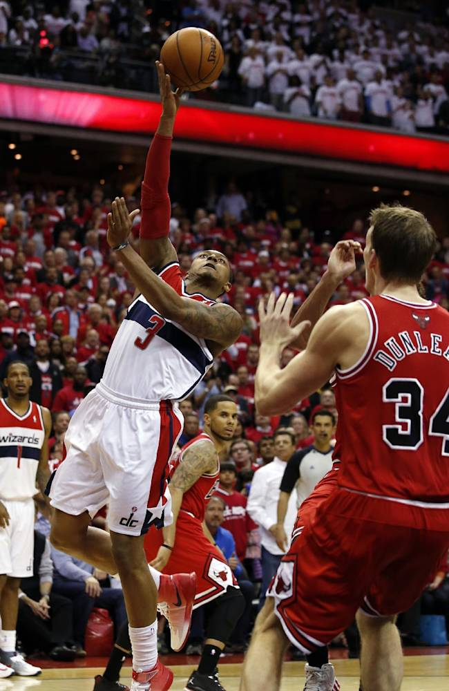 Washington Wizards guard Bradley Beal (3) shoots over Chicago Bulls forward Mike Dunleavy (34) in the second half of Game 3 of an opening-round NBA basketball playoff series on Friday, April 25, 2014, in Washington. The Bulls won 100-97