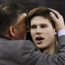 CORRECTS SCORE TO 91-79 - Creighton coach Greg McDermott, left, hugs his son Doug McDermott, after Doug left the game late in the second half of an NCAA college basketball game against Wichita State in Omaha, Neb., Saturday, March 2, 2013. McDermott scored 41 points in Creighton's 91-79 win. (AP Photo/Nati Harnik)