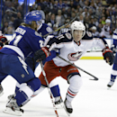 Columbus Blue Jackets left wing Matt Calvert (11) loses the puck after getting hit by Tampa Bay Lightning defenseman Mike Kostka (21) during the first period of an NHL hockey game Friday, April 11, 2014, in Tampa, Fla The Associated Press