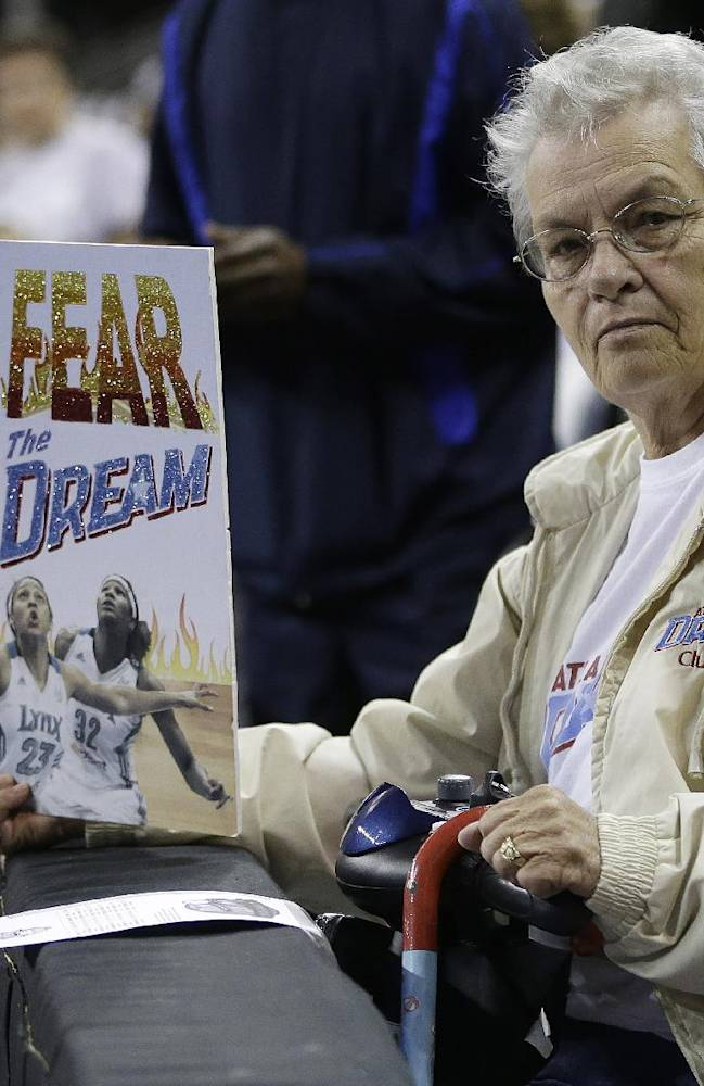Carol Witcher, of Walnut Grove, Ga. waits for the Atlanta Dream to take the court before the first half of Game 3 of the WNBA Finals basketball game against the Minnesota Lynx in Duluth, Ga., Thursday, Oct. 10, 2013