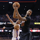Phoenix Suns' Markieff Morris (11) pulls catches a pass over Oklahoma City Thunder guard Russell Westbrook during the second half of an NBA basketball game on Thursday, March 6, 2014, in Phoenix. The Suns won 128-122 The Associated Press
